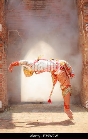 Hanuman (monkey god) somersaults in Khon or Traditional Thai Pantomime as a cultural dancing arts performance in masks dressed based on the characters - Stock Photo