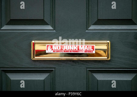 No junk mail sticker on brass letter box - Stock Photo