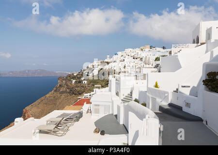 SANTORINI, GREECE - MAY 2018: View over Aegean sea, Firostefani village and volcano caldera with luxury hotelon the foreground. Santorini island, Gree - Stock Photo
