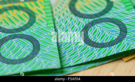 Macro closeup of Australian one hundred dollar notes, shallow dof. - Stock Photo