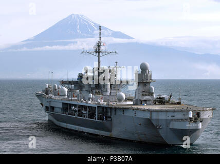 SHIMIZU, Japan (May 30 2008) The amphibious command ship USS Blue Ridge (LCC 19) steams within sight of Mt. Fuji on its final stop to Shimizu, ending a six-week Spring Swing tour. Blue Ridge serves under Commander, Expeditionary Strike Group (ESG) 7/Task Force (CTF) 76, the Navy's only forward deployed amphibious force. U.S. Navy - Stock Photo
