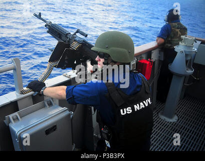 OCEAN (Jan. 29, 2009) A Sailor on the port bridge wing of the guided-missile cruiser USS Lake Champlain (CG 57) mans a .50-caliber machine gun before a live-fire exercise. Lake Champlain is part of the Boxer Expeditionary Strike Group/13th Marine Expeditionary Unit and is on a scheduled deployment to the western Pacific supporting global maritime security. - Stock Photo