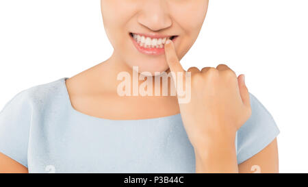 Woman looking in mirror and checking teeth - Stock Photo