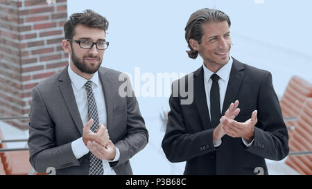 business partners applauding ,standing in the office - Stock Photo