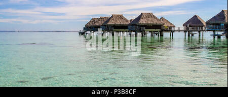 Overwater bungalows in Moorea, French Polynesia - Stock Photo
