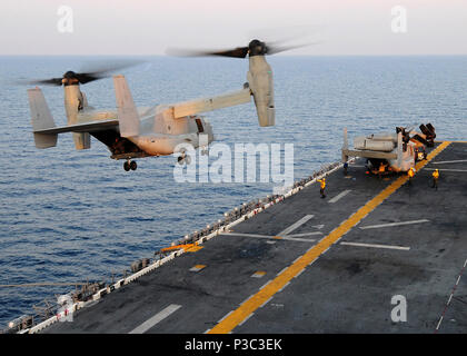 A U.S. Marine Corps MV-22B Osprey aircraft from Marine Medium Tiltrotor Squadron (VMM) 263, 22nd Marine Expeditionary Unit (MEU) takes off from amphibious assault ship USS Bataan (LHD 5) Nov. 6, 2009, in the Indian Ocean. Ospreys are being flown to Camp Bastion, Afghanistan, where they will be transferred to VMM-261 and used to support the 2nd Marine Expeditionary Brigade. This is the first time the aircraft will be used in Afghanistan. The 22nd MEU is serving as the theater reserve force for U.S. Central Command. - Stock Photo