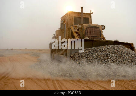 PROVINCE, Afghanistan (Dec. 8, 2009) Equipment operators assigned to Naval Mobile Construction Battalion (NMCB) 74 use up-armored bulldozers and rollers to spread and roll gravel at a convoy route development project. NMCB-74 has been charged with improving key convoy routes in Helmand Province, Afghanistan. - Stock Photo