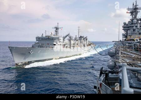 180615-N-AO674-1201 ATLANTIC OCEAN (June 15, 2018) The Wasp-class amphibious assault ship USS Kearsarge (LHD 3) conducts a replenishment-at-sea with the Military Sealift Command fast combat support ship USNS Supply (T-AOE 6). Kearsarge is underway conducting routine certifications to maintain unit readiness. (U.S. Navy photo by Mass Communication Specialist 2nd Class Michael R. Sanchez/Released) - Stock Photo