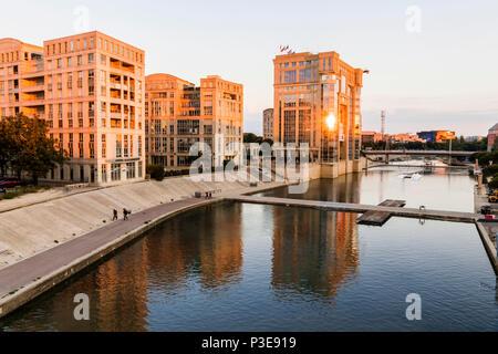 Montpellier, France. Sunset at the river Lez, with the Hotel de Region Occitanie et Languedoc-Roussillon (Occitan Regional Council) in the Quartier An - Stock Photo