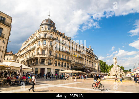 Montpellier, France. The Place de la Comedie, a historic square, with the Fountain of Three Graces and the Le Scaphandrier building - Stock Photo