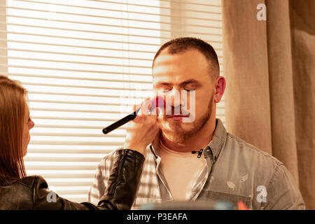 Make-up of man actor before shooting close up - Stock Photo