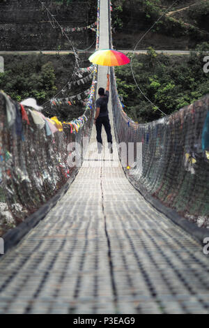 The crazy long suspension bridge built over pho chhu river in Punakha - Stock Photo