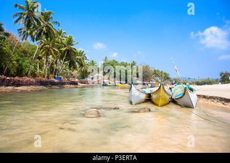 Beautiful view on delta of  Baga river with wooden outrigger fishing boats at Calangute beach, Goa, India - Stock Photo