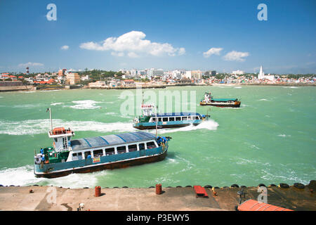 Tree ferryboats in the most southern point of India where two oceans come together, Kanyakumari, India - Stock Photo
