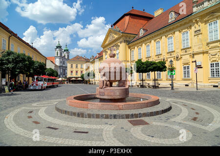 The Orb in the middle of City Hall Square with the Episcopal Palace and Cistercian church.Szekesfehervar was the capital of Hungary in the Middle Ages - Stock Photo