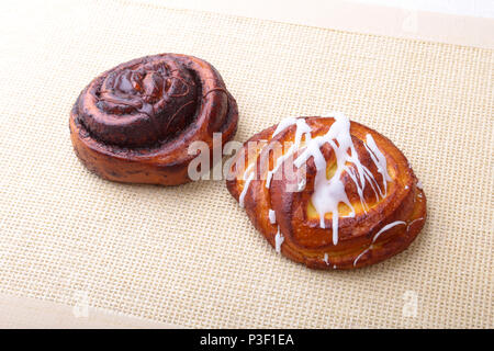 Freshly baked homemade sweet rolls with cinnamon on white background. Healthy Food Snack Concept. Copy space. - Stock Photo