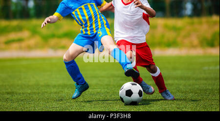 Junior Football Match Competition. Two Young Footballers Running and Competing For Ball. Youth Soccer Tournament - Stock Photo