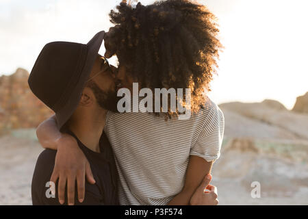 Couple kissing each other at beach - Stock Photo