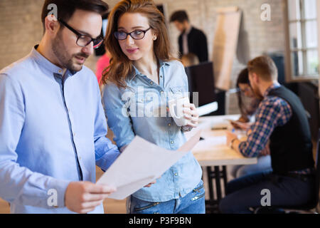 Business coworkers celebrate achieved goals in office - Stock Photo
