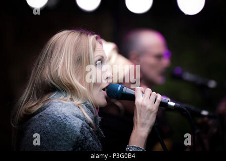 Janice Mitchelson vocalist with The Grace Notes performing at Trebah Garden amphitheatre in Cornwall. - Stock Photo