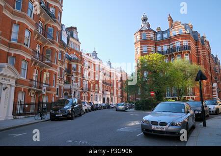 Elegant red brick mansion blocks in Kensington Court, Royal Borough of Kensington and Chelsea, London W8, England, UK - Stock Photo