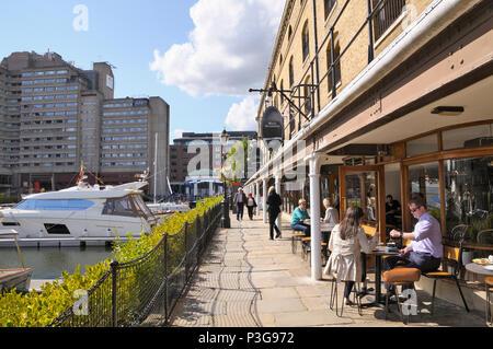 Cafés and restaurants along the marina at St Katharine Docks, Tower Hamlets, London, England, UK - Stock Photo