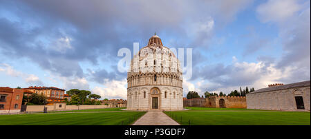 Panoramic view of Piazza dei Miracoli (Square of Miracles) or Piazza del Duomo (Cathedral Square) with Pisa Baptistery in the morning light, Pisa, Tus - Stock Photo