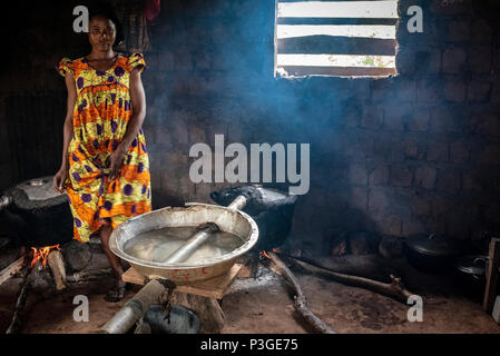 making local moonshine or liquor with homemade still Awae, Cameroon, - Stock Photo