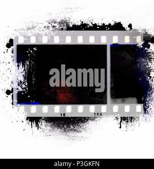 Grunge film strip frame on black dripping background. - Stock Photo