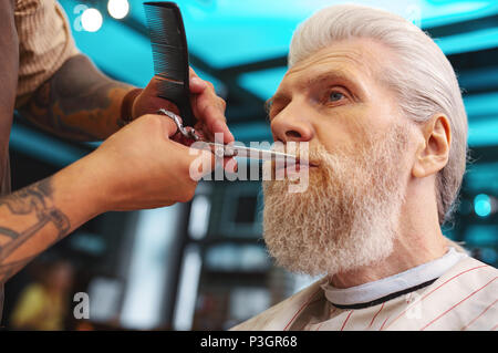 Low angle picture of mature man that looking forward - Stock Photo