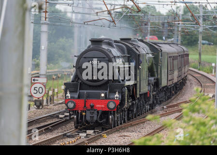 Winwick Cheshire United Kingdom.  18th June 2018. The world's most famous steam locomotive, LNER A3 Class 4-6-2 no 60103 Flying Scotsman seen crossing Winwick Junction on the West Coast Main Line behind Stanier Black Five  LMS Class 5MT 4-6-0 no 45212 loco hauling day 1 of Steam Dreams railtour The Lakes Express. Credit: John Davidson Photos/Alamy Live News - Stock Photo