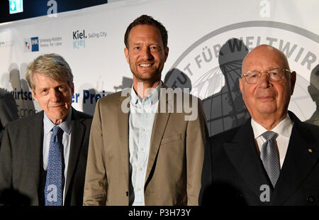 17 June 2018, Germany, Kiel: The winners of the Global Economy Prize (left to right), American Robert Shiller, Economist and Nobel laureate, Dutch Bas van Abel, founder of the company Fairphone, and Klaus Schwab, founder of the World Economic Forum in Davos, standing together. The Institute for Global Economy awarded for the 14th time prizes in the categories politics, economy and science to promoters of a cosmopolitan, market-based and fair society. Photo: Carsten Rehder/dpa - Stock Photo