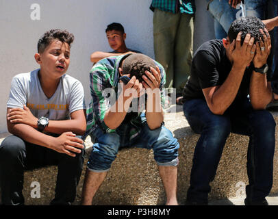 Relatives of the martyr seen crying during his funeral at Shifa Hospital in Gaza City. Sabri Ahmed Abu Khader, 24, killed on the Gaza Strip border east of Gaza City by the Israeli occupation. - Stock Photo