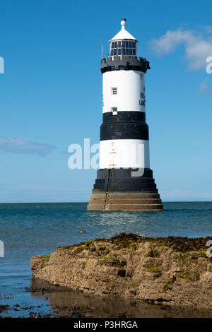 Trwyn Du Lighthouse is a lighthouse between Black Point near Penmon and Ynys Seriol, or Puffin Island, at the eastern extremity of Anglesey, marking t - Stock Photo