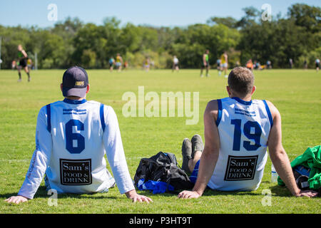 Austin, Texas/USA - October 19, 2014: The United States Australian Football League Championship in Austin, Texas. Two players watch from the sideline. - Stock Photo