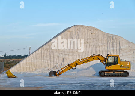 Machinery stationed at a salt production facility in Ludo. Algarve, Portugal - Stock Photo