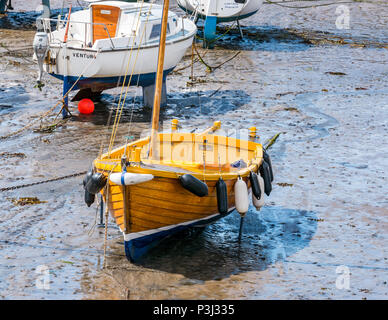 Wooden sailing boat and other boats in mud at low tide, North Berwick harbour, east Lothian, Scotland, UK - Stock Photo