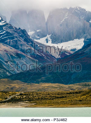 Lake with granite mountain towers of Torres del Paine National Park, Patagonia, Chile, South America - Stock Photo