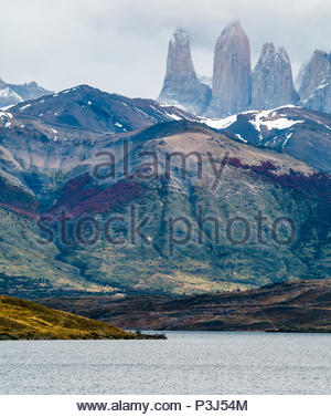 Lake in front of granite Towers of Paine shrouded in cloud, Torres del Paine National Park, Patagonia, Chile - Stock Photo