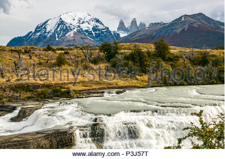 Cascado Rio Paine, waterfall cascade and rapids on River Paine with granite Towers, Torres del Paine National Park, Patagonia, Chile - Stock Photo