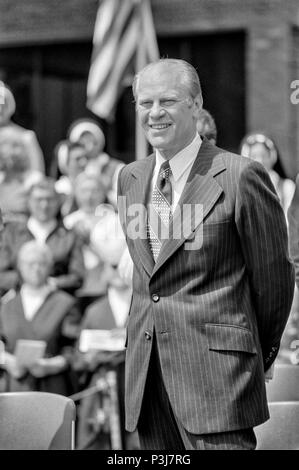 FORT SMITH, AR, USA - AUGUST 10, 1975 -- President Gerald R. Ford waits to speak as he is being introduced before a crowd of thousands of South Vietnamese refugees recently evacuated from their country as it fell to North Vietnamese forces. - Stock Photo