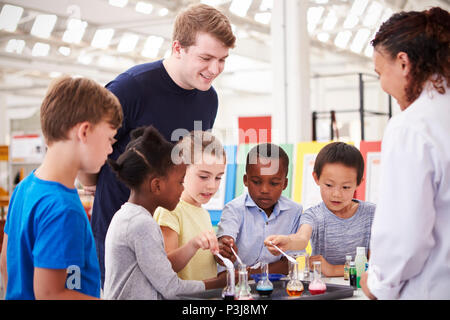 School kids taking part in a science experiment, close up - Stock Photo