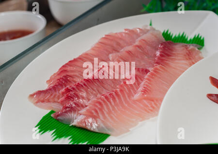 Tai Sashimi : Sliced Raw Tai (Red Seabeam Fish) Served with Sliced Radish on Stone Plate. - Stock Photo