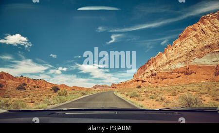 Retro toned picture of a road seen through a windshield, travel concept. - Stock Photo