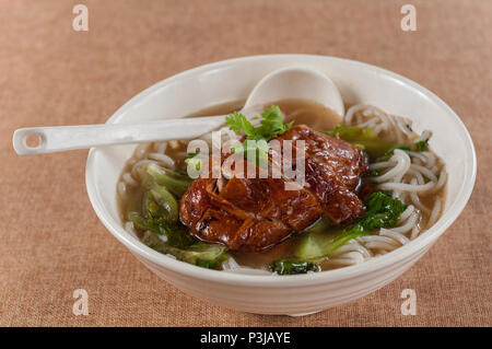 Popular Asian Cuisine - Slices of Roasted Peking Duck with Rice Noodles Soup Bowl - Stock Photo