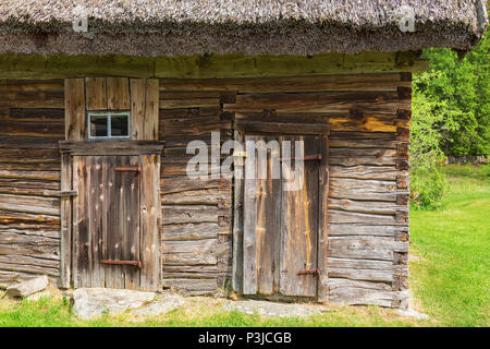 Old timber barn in the countryside - Stock Photo