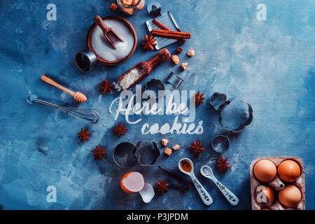 Header with baking tools and ingredients on a stone kitchen table. Here be cookies text made with flour. Food typography concept with copy space. - Stock Photo