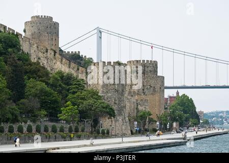 ISTANBUL, TURKEY - MAY 24 : The Fortress of Rumeli Hisari and Fatih Sultan Mehmet bridge in Istanbul Turkey on May 24, 2018. unidentified people - Stock Photo