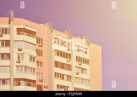 Multi-storey house with lots of windows, balconies and air conditioning. Detail photo of old skyscraper in Russia and Ukraine - Stock Photo