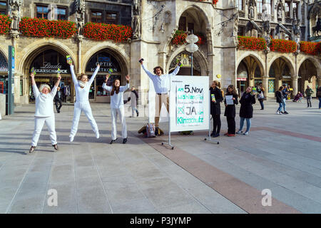Munich, Germany - October 25, 2017: Political picket of jumping activists environmentalists against coal to Marienplatz - Stock Photo